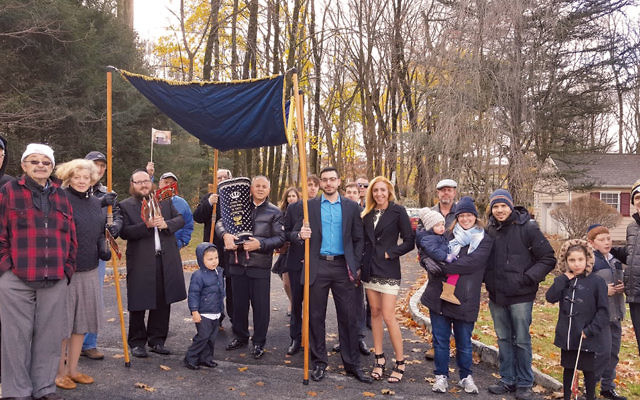 The new Torah scroll is received by members of the Chabad of Suffern.
