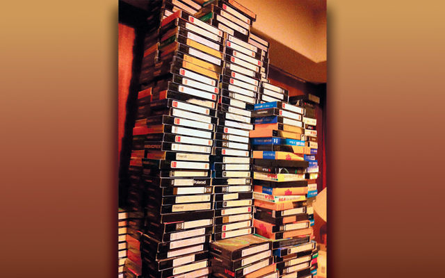 This is one of the many towers of VCR tapes in Judy Batalion's childhood home; the tapes were just one of many collections her mother amassed.