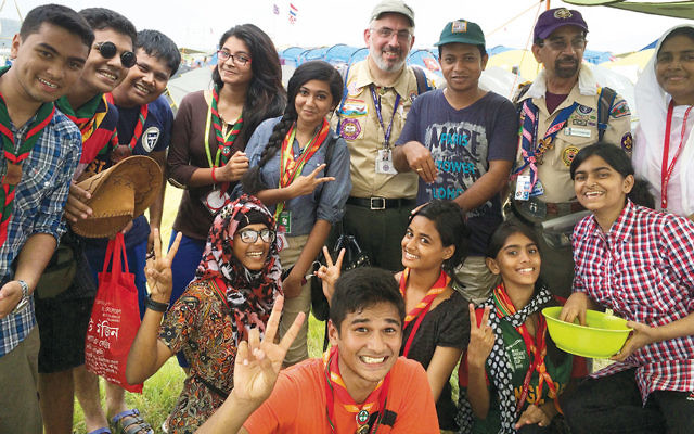 Two summers ago, Rabbi Joseph Prouser went to the International Jamboree in Japan. Here, he stands with the Bangladeshi contingent. (Girls are welcomed in Boy Scout troops overseas.)