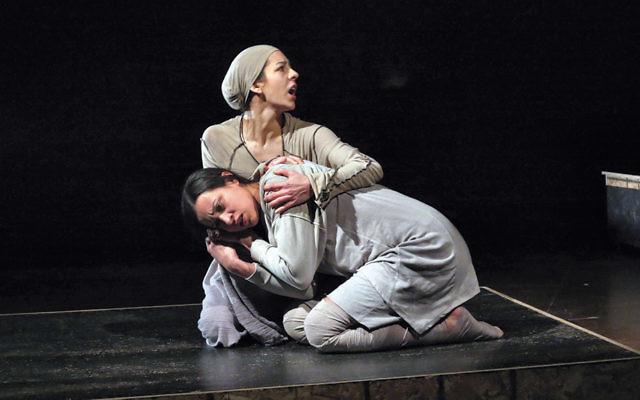 "Lily Leah Azrielant, as Rebecca, cradles Veracity Butcher as Silvana Hajaj, in ""Benghazi Bergen-Belsen."" (Jonathan Slaff)"