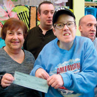 Linda Cohen of the Jersey Hills section of the National Council of Jewish Women presented a $1,500 check to the Opportunity Center in Fair Lawn. She is shown here with some of the center's clients. The chapter has been a long-time supporter of the center, a year-round day program for adults with developmental disabilities; it is a private, nonsectarian, not-for-profit organization. (Courtesy NCJW)