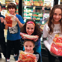 Religious school students from Temple Emanuel of the Pascack Valley visited a local supermarket to learn what to look for when selecting kosher foods. (Courtesy TEPV)