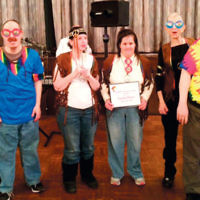 J-ADD residents celebrated Purim wearing 1960s-themed Purim costumes. The annual J-ADD Purim party with dinner and dancing was sponsored by the sisterhood of Congregation Beth Sholom of Teaneck. (Courtesy J-ADD)