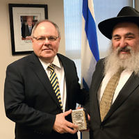 Dani Dayan, Consul General of Israel, left, with Rabbi Mordechai Kanelsky, Bris Avrohom's executive director. They met to talk about the activities and programs Bris Avrohom provides to the Jews from the former Soviet Union. In anticipation of their partnership in programs with Israel, Rabbi Kanelsky presented Consul Dayan with a tzedakah box with engravings of the Western Wall, Chabad Lubavitch headquarters, and Bris Avrohom's logo. (Courtesy Bris Avrohom)