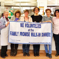 Members of the tikkun olam committee at Temple Israel & JCC of Ridgewood prepared and served a hearty meal to clients of the Bergen County Human Services Center in Hackensack. The dinner was part of the monthly Family Promise Walk-in Dinner program. Teens from TI-JCC's youth group baked heart-shaped cookies for dessert. (Courtesy Temple Israel & JCC)
