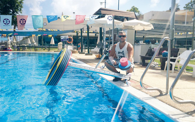 Above and below, Asaf Ventura poses with his floating gym at an Israeli army rehabilitation center in Haifa in June 2015. (Courtesy Asaf Ventura)