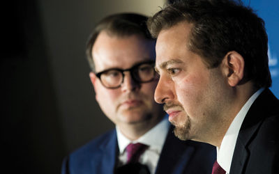 Evan Bernstein, left, and Oren Segal of the Anti-Defamation League at a news conference at ADL headquarters in Manhattan on March 3, talking about the arrest of Juan Thompson. (Drew Angerer/Getty Images)