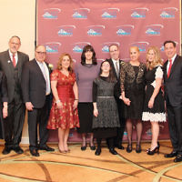 From left, honorees Moshe and Orit Zharnest; Sinai's dean emeritus, Laurette Rothwachs; the chair of Sinai's board, Rabbi Mark Karasick; honorees Moshe and Esther Muschel; honorees Malca and Rabbi Chaim Jachter and their daughter, Chaya Ziporah; Sinai's chief development officer, Esti Herman; honorees Ilana and Adam Chill; Sinai's vice president, Danny Federbush; Sinai's dean, Rabbi Yisrael Rothwachs, and its managing director, Sam Fishman.