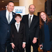 Rabbi Yisrael Rothwachs; Sinai's president, Avi Vogel; Cantor Joseph Malovany with his son, Ellis Malovany, and his grandchildren.