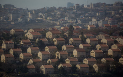 JERUSALEM, ISRAEL - JANUARY 15: Houses part of an Israeli settlement are seen in front of an Arab town on January 16, 2017 in Amona, West Bank. 70 countries attended the recent Paris Peace Summit and called on Israel and Palestinians to resume negotiations that would lead to a two-state solution, however the recent proposal by U.S President-elect Donald Trump to move the US embassy from Tel Aviv to Jerusalem and last month's U.N. Security Council resolution condemning Jewish settlement activity in the West Bank have contributed to continued uncertainty across the region. The ancient city of Jerusalem where Jews, Christians and Muslims have lived side by side for thousands of years and is home to the Al Aqsa Mosque compound or for Jews The Temple Mount, continues to be a focus as both Israelis and Palestinians claim the city as their capital. The Israeli-Palestinian conflict has continued since 1947 when Resolution 181 was passed by the United Nations, dividing Palestinian territories into Jewish and Arab states. The Israeli settlement program has continued to cause tension as new settlements continue to encroach on land within the Palestinian territories. The remaining Palestinian territory is made up of the West Bank and the Gaza strip. (Photo by Chris McGrath/Getty Images)