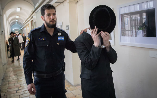 A haredi man arriving for a court hearing in Jerusalem after being arrested for alleged sexual assault, March 27, 2017. (Yonatan Sindel/Flash90)