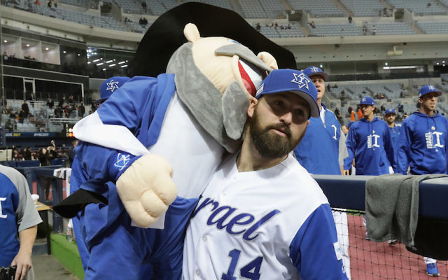 Infielder Cody Decker holding the Israeli team's mascot, a life-sized Mensch on a Bench, after defeating the Netherlands in a World Baseball Classic game at the Gocheok Sky Dome in Seoul, South Korea, March 9, 2017. (Chung Sung-Jun/Getty Images)