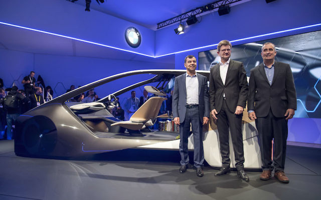 From left: Amnon Shahua, chairman and chief technology officer of Mobileye, Klaus Froehlich, member of the management board at BMW, and Brian Krzanich, chief executive officer of Intel Corp., at a press event at Consumer Electronics Show in Las Vegas, Jan. 4, 2017. (David Paul Morris/Bloomberg/Getty Images)