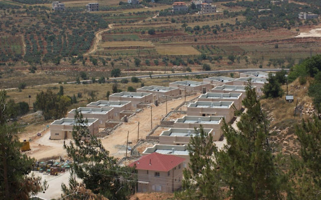 New houses being constructed in Shiloh, a Jewish settlement in the West Bank, in 2013. (Ryan Simon via CC)