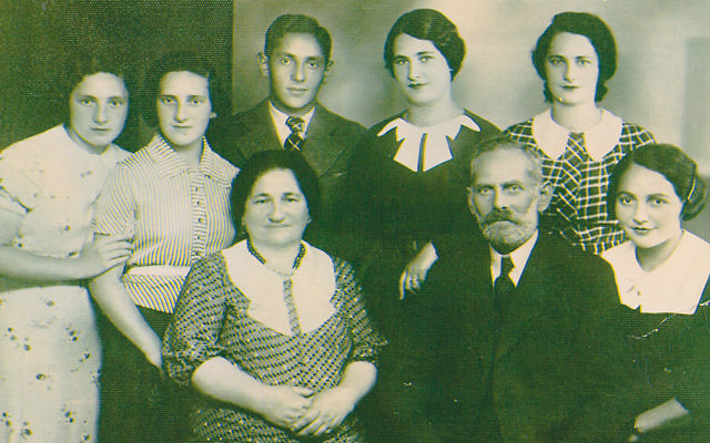 This is the only photo Dr. Felsen has of her family. Her father, Abraham Felsen, is in the center; her grandparents, Helen Oberland and Herman Felsen, are surrounded by five of their seven daughters.