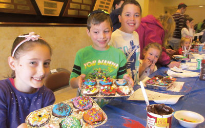 Children make cupcakes for a homeless shelter in Queens.