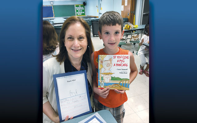 Nilene Evans Chase and her reading buddy at Hackensack's Fairmount School