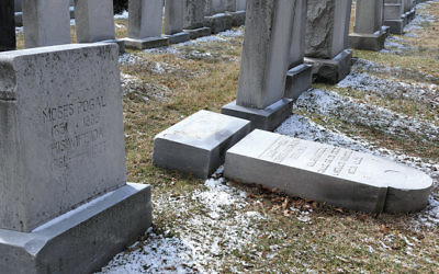 A gravestone was vandalized at the Waad Hakolel Cemetery in Rochester, N.Y., in March. (Gretchen Stumme/AFP/Getty Images)