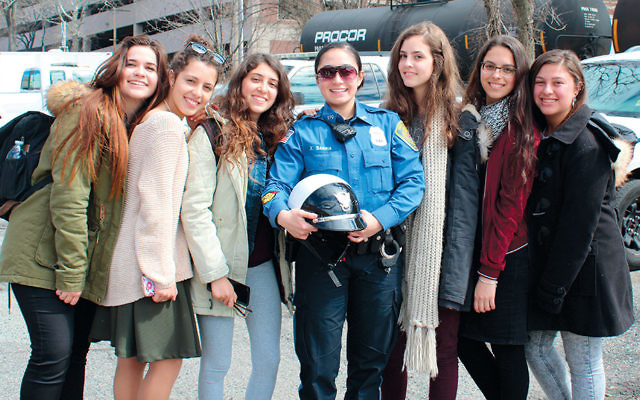 The group is with an Englewood Police motorcycle officer, one of the few female motorcycle officers on the force. (Courtesy JFNNJ)
