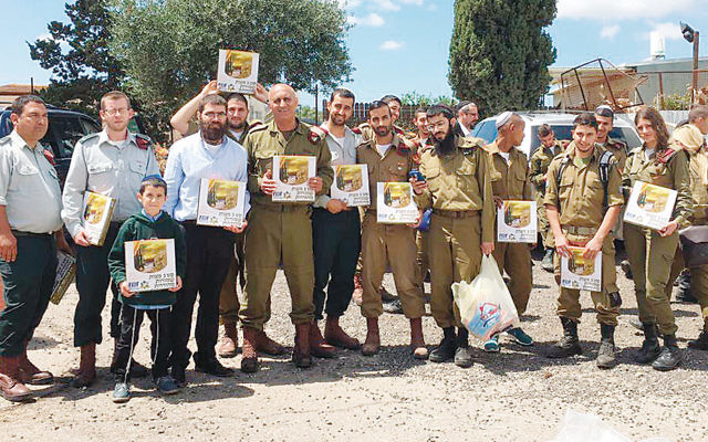 IDF soldiers hold donated matzah. (Photos courtesy FIDF)