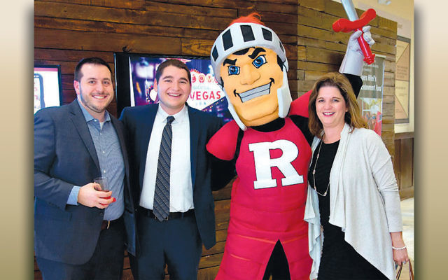 Ben Kern joins with his parents and the Rutgers Scarlet Knights mascot. (Photos by Mike Schwartz Photography, courtesy Rutgers Hillel)