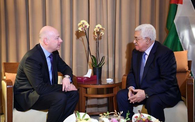 Palestinian President Mahmoud Abbas, right, meeting with Jason Greenblatt, U.S. President Donald Trump's envoy, at the Arab League Summit in Amman, Jordan, March 28, 2017.