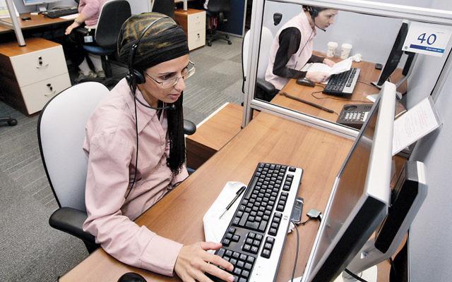 Women at work at a company in Modiin Elit, Israel. (Abir Sultan/Flash90)