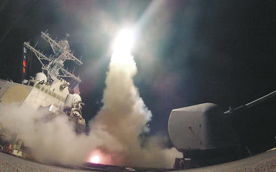 The USS Porter fires a Tomahawk missile at a Syrian military airfield in the Mediterranean Sea on April 7.  (Ford Williams/U.S. Navy via Getty Images)