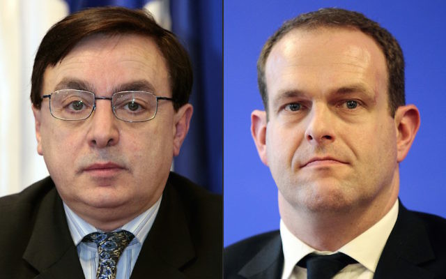 Jean-François Jalkh, left, has been replaced at the top of France's far-right National Front party by Steeve Briois, Henin-Beaumont's mayor and a European Parliament member. (Jacques Demarthon/AFP/Getty Images)