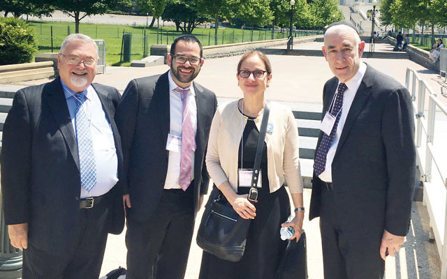 From left, delegation members Rabbi Stephen Roth of Eitz Chaim in Passaic, Rabbi Andrew Markowitz of Shomrei Torah of Fair Lawn, mission co-chair Dr. Laurie Baumel, and Rabbi Benjamin Yudin, also of Shomrei Torah in Fair Lawn.