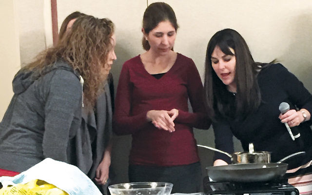 Naomi Nachman, right, stands with a team at Bnai Yeshurun.