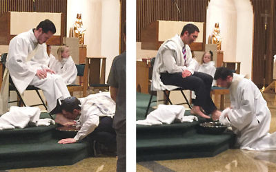 Rabbi Paul Jacobson and Father Camilo Cruz wash each other's feet in a Holy Thursday ritual.