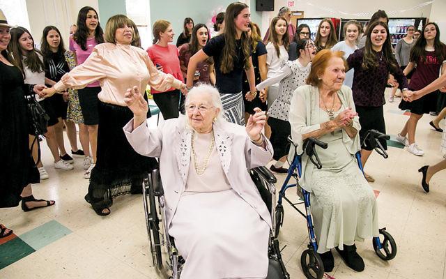 Ruth Weiss, left, and Mitzi Krampf celebrate at Ma'ayanot.