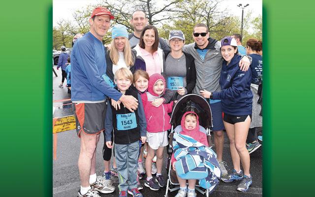 Brandi Katz Rubin, wearing #1538, her husband Jed, and her family stand together before last year's  Rubin Run.