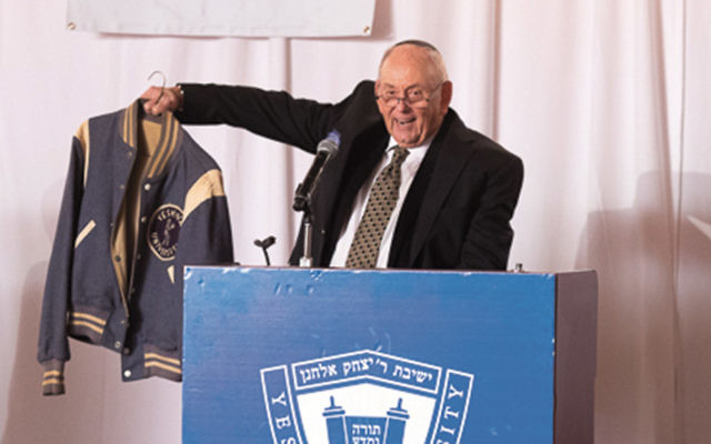 Herbert Schlussel shows his varsity jacket from his playing days in the 1950s.