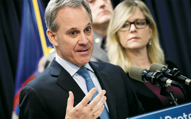 New York state Attorney General Eric Schneiderman speaks at a news conference in Manhattan to announce the takedown of a large organized crime ring in March.