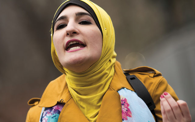 Linda Sarsour speaks during a Women for Syria gathering at Union Square in Manhattan on April 13. (Drew Angerer/Getty Images)