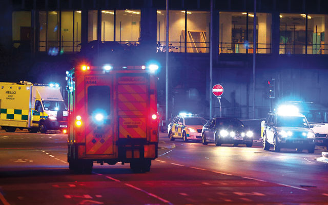 Emergency responders arrive at the Manchester Arena in response to a bomb attack at an Ariana Grande concert on May 22. (Dave Thompson/Getty Images)