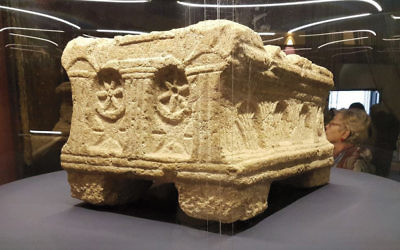 The Magdala Stone gets its public debut at the Nel Braccio Di Carlo Magno Museum in the Vatican's St. Peter's Square. The stone has a menorah carved into it. (Magdala Center and Israel Antiquities Authority)