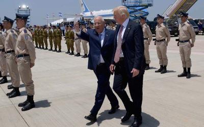 Israeli President Reuven Rivlin guiding President Donald Trump at Ben Gurion Airport near Tel Aviv, May 22, 2017. (Avi Ohayon/Israeli Government Press Office/Flash90)