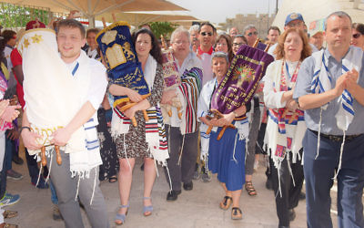 WUPJ members march to the Kotel; the people carrying sifrei Torah are from Russia, Germany, the UK, and Israel.