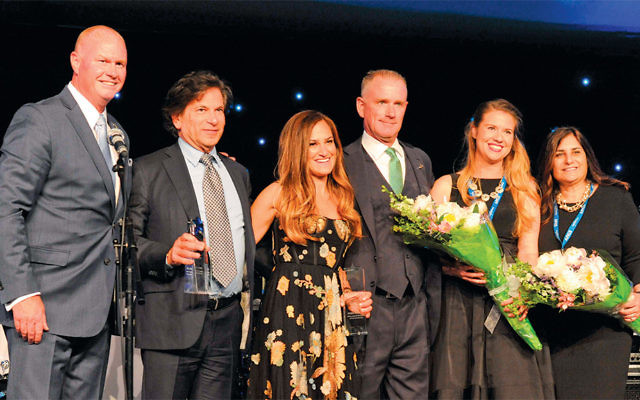 CareOne CEO Daniel Straus, second from left, and Elizabeth Straus, center, its executive vice president, were celebrated as the joint recipients of the Make-A-Wish New Jersey 2017 Humanitarian of the Year award on June 8 at the organization's gala. With them, from left, are Tom Weatherall, Make-A-Wish New Jersey's president and CEO; Frank Bolte, the organization's board chair; and Emily Schonberg and Rosemarie Farr, both with Make-A-Wish. (Laura Pedrick/AP Images for CareOne Management)