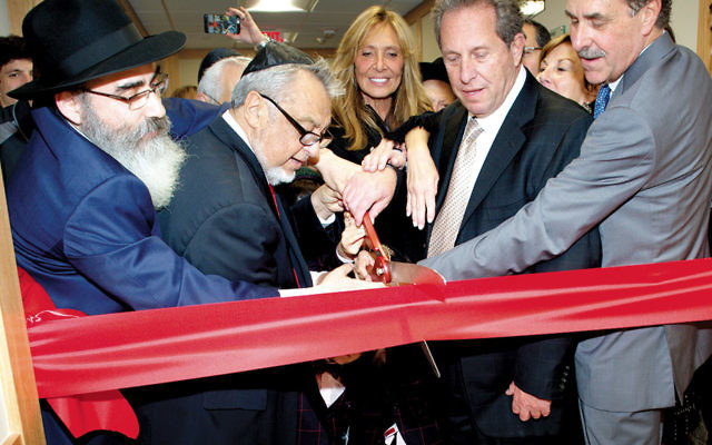 Rabbi Mordechai Shain cuts the ribbon with, from left, founders Josh Lapsker, Aron Forem, and Michael Young. (Rafael Dayan Photography)