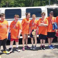 Eight members of Emeth Teen Community, a teen service and leadership program from Temple Emeth in Teaneck, joined with Rabbi Steven Sirbu, at right, to volunteer at the JFCS Wheels for Meals ride on June 11. They were transported in style thanks to shul member David Steiner. With Rabbi Sirbu, from left, are Joseph Conlon, Michael Conlon, Luke Conlon, Kyla Ginsberg, Evelyn Pierce, Austin Steiner, Jacob Newman, and Ryan Zaken.  (Courtesy Rabbi Sirbu)