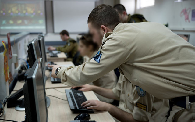A group of IDF cyber cadets look at data during a training exercise. (IDF)