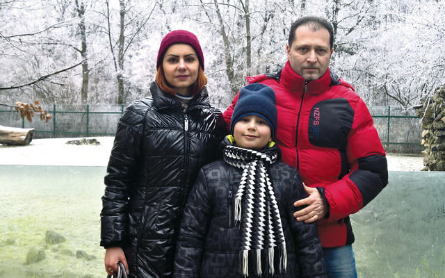 Dan Sofer, his wife, and their son (who asked to remain unidentified) in Vilnius, Lithuania, in December 2016. (Courtesy of Sofer family.)