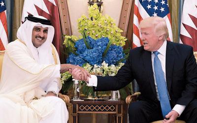 President Donald Trump meets with Qatar's Emir Sheikh Tamim Bin Hamad Al-Thani in a hotel in Riyadh, Saudi Arabia on May 21. (Mandel Ngan/AFP/Getty Images)