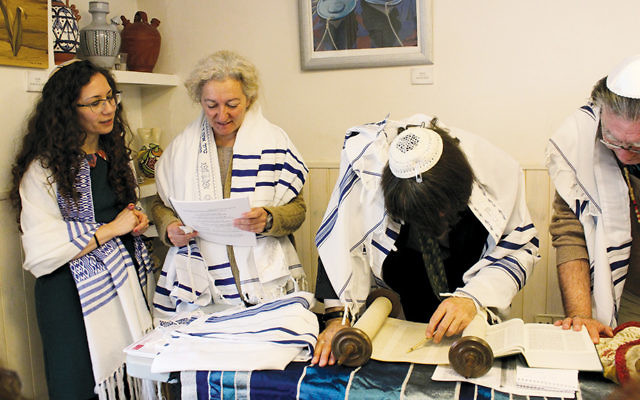 From left, Yael Cobano, Ruth Timon, Rabbi Stephen Berkowitz, and Zohar Ben-David participating in the Torah reading at the Reform Jewish Community of Madrid.