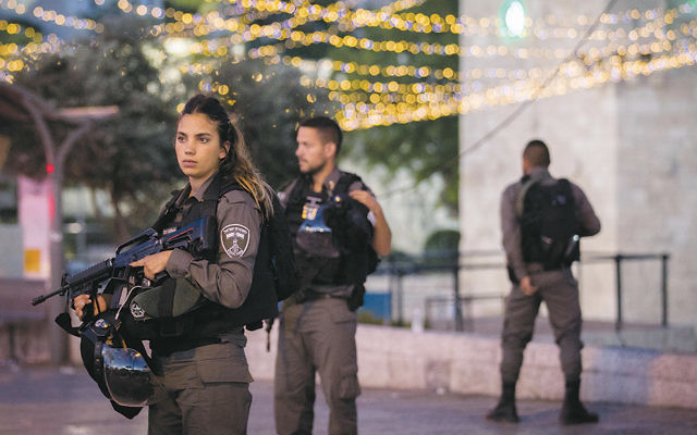 Israeli security forces stand at the scene of a terrorist attack in Jerusalem on June 16. (Yonatan Sindel/Flash90)