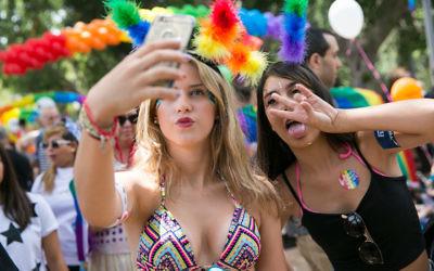 Young Israeli women among the some 200,000 celebrating Gay Pride in Tel Aviv, June 3, 2016. (Yaniv Nadav/Flash90)